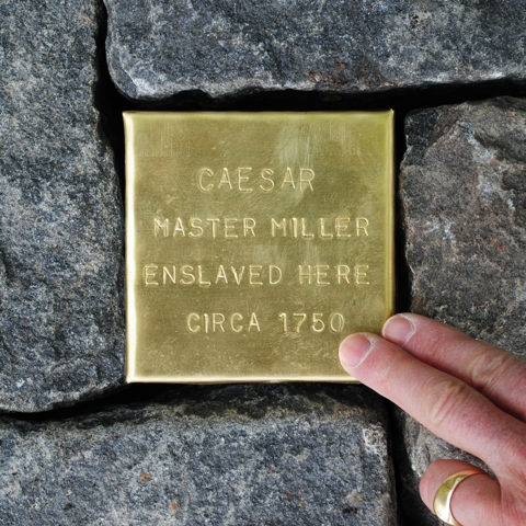 Touching Stone installed in a cobblestone street